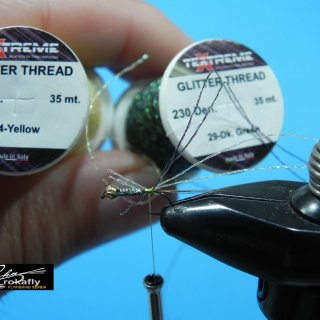 <p>Hook : Gamakatsu F11 size 14 Head : Gold tungsten,lead Tail : Rooster feather grizzly,brown Tread : Textreme Lt.olive 6/0 Body woven : Textreme two thread Glitter Yellow and Dk.Green Legs : Feather partridge Torax : Brown women's nail polish</p>